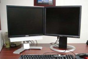 Twee schermen met één hoofdscherm en één bijscherm